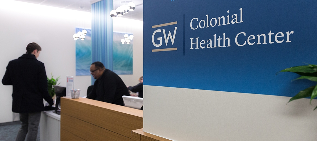 Person at desk of Colonial Health Center