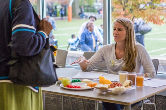 Student talking at a table with food